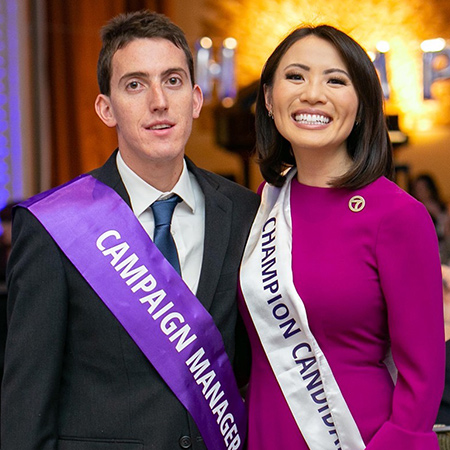 Female champion candidate standing next to her campaign manager