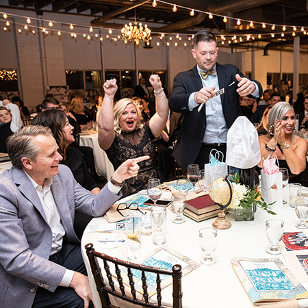 Gala attendees celebrating at table